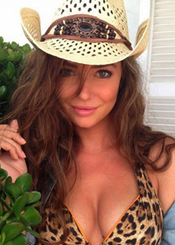 sexy girl in a cowboy hat and decolette
